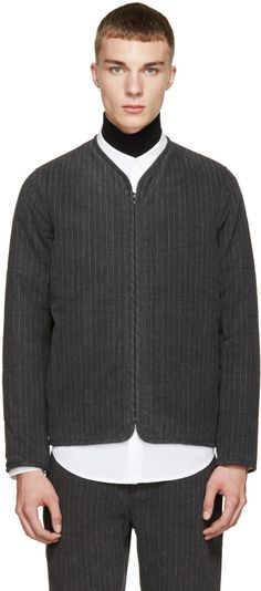 Long sleeve quilted jacket in grey featuring a pale grey pinstripe throughout. Concealed zip closure at front. Welt pockets at waist with press-stud closure. Fully lined. Tonal stitching.