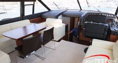 In dinner mode on the Prestige 60, the cocktail table is raised and the five light-weight and stylish chairs are taken out of storage for the occasion. In this way the 60 gives you both a large saloon and a formal dining table.