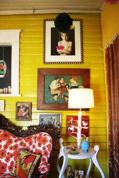 I want to tour this house. It is amazing! LOVE the painting of the ladies playing cards! And the couch...