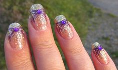 "Ida Pie: NOTW - Gold Finger/I stamped with Purple Konad Special Polish using Konad Image Plate M64. To top it off I placed a Purple Rhinestone at the center of the print. All it needed not was a layer of Top Coat. Really simple Manicure to do. really liked this manicure. The purple went well with the gold. What do you think?And that is a ""Piece of Pie"" - Thank you for reading!"