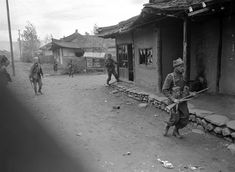 British and Australian troops search houses in Hwangju on Oct. 17, 1950 in mopping up operations during the drive toward Pyongyang, Capital of North Korea
