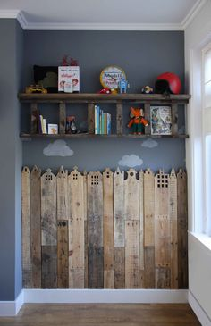 The creative work of a young Dutch mother who carved out wood planks to look like little buildings as wall decor for her child's bedroom / de Wereld van HABA