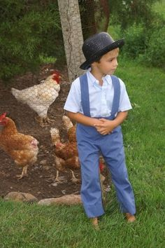 amish boys | Amish boy...with his hens and roosters to take care of.