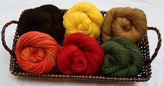 Sock Lovers Delight Holiday Gift Basket features six skeins of Cascade's Heritage Sock Yarn in Solids, Quatros, and Paints. Each 75/25 Merino and Nylon skein is enough to knit one adult pair of socks.
