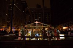 Snowy December Engagement Session - Mary & William - Emma Mullins Photography. Nativity scene at Christkindlmart, Chicago in Daley Plaza.