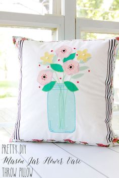 Pretty DIY Mason Jar Flower Vase Pillow - this fun project will brighten up your sofa for Spring and Summer!