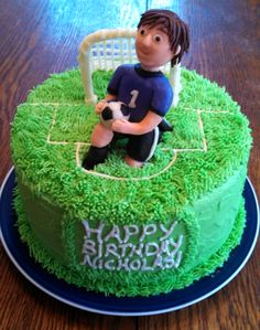 Soccer themed cake for the Goalie's birthday! All buttercream with candy clay birthday boy and net! All edible! 8 in round 2 layer cake. https://www.facebook.com/angelas.cakes2011