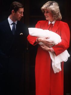 Prince Harry soon after birth, being held by his mother, Princess Diana, and father, Prince Charles.