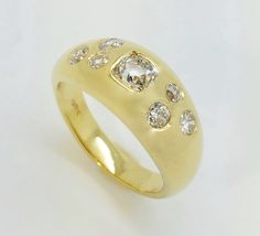Old cut diamonds gypsy set into an 18 carat yellow gold ring