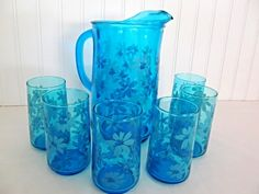 Groovy blue pitcher and glasses with raised flowers make this set a must have addition!  The deep blue color is the perfect background for the
