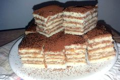 Reteta culinara Desert prajitura cu foi fragede si crema de ciocolata din categoria Prajituri. Specific Romania. Cum sa faci Desert prajitura cu foi fragede si crema de ciocolata