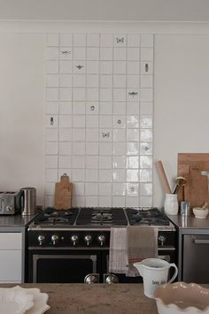 Insect tile backsplash in kitchen of Victorian remodel in St Vincent Place, Melbourne by O'Connor Houle | Remodelista