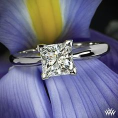 This Platinum 4 Prong Solitaire Engagement Ring holds a simply stunning 1.21 ct I VS1 Super Ideal Princess Cut Diamond Whiteflash A CUT ABOVE® selection