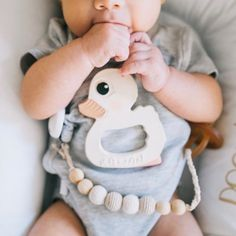 Little Alexander just began teething, luckily he has his fingers and Kawan the Duck. $2.95. ___ Photo Cre