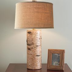 Birch Column Table Lamp                                      Bring a touch of the great outdoors inside with this rustic, yet updated birch veneer wrapped table lamp with textured beige drum shade.