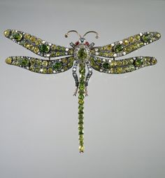 Brooch in the form of a dragonfly, circa 1890. Composed of gold, diamonds, rubies, demantoid garnets and beads.