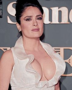 Salma Hayek huge cleavage in a plunging halter dress