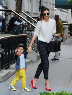 Miranda Kerr - street style - white fluffy jumper, black/white print pants & red heels