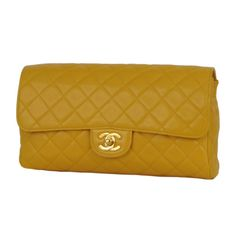 Vintage Canary yellow classic quilted Chanel single flap clutch with gold mademoiselle closure.