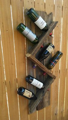 6 bottle wine rack made from recycled fence. This wine rack is made from a 20 year old fence that a tree knocked down in my yard. Attaches to any wall with 4 screws measures 4ft tall by 1ft wide