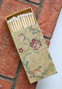 Gold Tapestry Match Box- who knew cute matches for the bathroom actually existed.