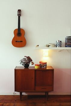 Good idea -- hang the guitar on the wall where it doubles as art. That little lion on the shelf? rawrrrr!