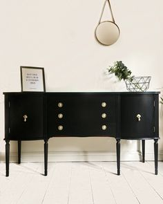 Vintage serpentine sideboard painted in coal black by fusion mineral paint. Sprayed gold handles. Available to buy!