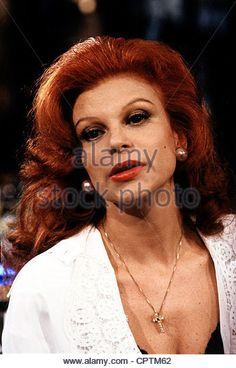 Milva (born Maria Ilva Biolcati), * 17.7.1939, Italian singer, portrait, 1990, red hair, necklace, cross, - Stock Image
