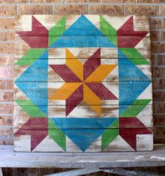 "A large 33"" x 33"" Barn Quilt with a Tulip and Star pattern, finished for use indoors and out."