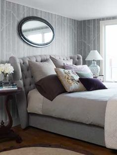 Grey, blue tones and dark colures cushions.