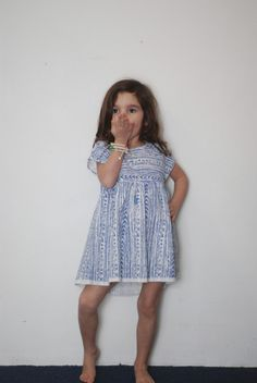 $41 Blue printed dress from Boy & Girl features a box cut for a great boho and flowy look. Empire waist and pleating details finish off this adorable dress. Casual and cool, this is a great summer staple.