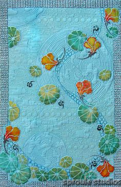What an absolutely beautiful ocean-inspired art quilt! Take a trip to the seaside with this totally stunning art quilt. Don't you love the blue color and seashell motif?