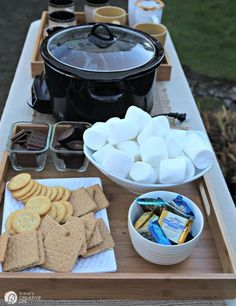 Yum, this makes us hungry. Try this delicious spread outside a Rising Barn. Get everyone together. Risingbarn.com. #spread #smores #backyard #food #dessert #delicious #graham #crackers #marshmallows #dark #chocolate #milk #crockpot