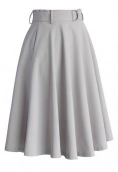 This neutral grey-hued frock boasts a huge wavy hemline. The neat a-line cut and belted high waist accents the best feminine silhouette wherever you go. Pair with simple tops to create an elite look for workdays.  - Back zip closure - D-ring belt accomanied - Side pockets - Lined - 100% Polyester - Machine washable  Size(cm) Length  Waist XS                62         66 S                  62        70 M                 62        74 L                   62        78 XL                 62      …