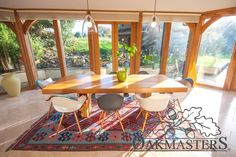 Modern glazed orangery style extension - Oakmasters - Light plays a game of shadows on this oak dining table Oak Framed Extensions, Garden Room Extensions, Oak Dining Table, Sunrooms, Outdoor Decor, Fig Tree, Modern, Conservatory, Brochures