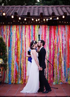 bright streamers ceremony backdrop, this site has several fun ideas for a backdrop