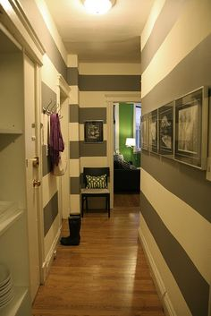 love the striped walls and green trellis pillow