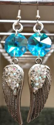 Pixies earrings $21.99 Shipping Included! Can you say FABULOUS? These gorgeous blue crystals dangle beautifully and catch the light like you wouldn't believe! Lovely silver Angel wings float below them with GLITTER coating! Covered with Hypo cement so the glitter doesn't stick to everything.