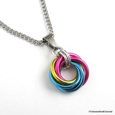 The pansexual pride chainmail love knot pendant necklace is a simple and understated necklace that is great for work or play. Pink, yellow and