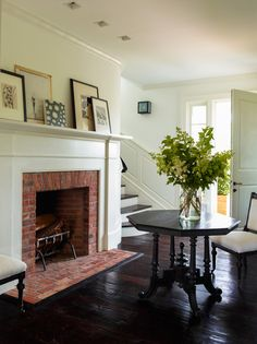 Brick hearth, white mantle Entrance of Wainscott NY Residence by Sawyer Berson, Hamptons, featured on Savvy Home Red Brick Fireplaces, Brick Hearth, Home Fireplace, Fireplace Design, Fireplace Trim, Modern Fireplaces, Farmhouse Fireplace, Fireplace Ideas, My Living Room