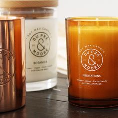 Our Aromatherapeutic, essential oil blend, candle range is housed in your choice of Amber vessel, or marble, with either a matte black or copper lid (not shown). The Perfumed candle range comes housed in a clear tumbler with natural wooden lid or a copper vessel with our engraved logo.