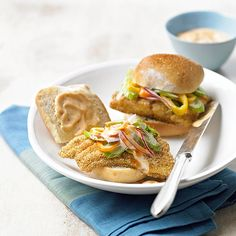 Cornmeal-Crusted Catfish Rolls with Slaw A tangy mixture of mayo, ketchup, and Cajun seasoning spices up these quick and easy mini sandwiches.