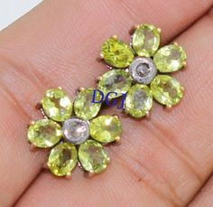 0.09CTS ROSE CUT DIAMOND PERIDOT VICTORIAN SILVER EARRING STUD MVE_00110  Rose Cut Diamond Clarity : I1-I2  Gorgeous Rose Cut Diamond Color : Tinted Brown  Silver Purity : 925  Gross Weight : 4.33 Gms ( Including Stone weight )