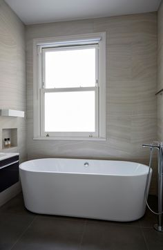 Neutral tones for this ensuite bathroom. Edwardian house renovation and extension. Dark floor tiles and pale wall tiles give dynamic contrast to the space. Freestanding bath with chrome tap and floating basin. Freestanding Bath, Edwardian House, Neutral Tones, Bathroom Interior Design, Corner Bathtub, Wall Tiles, Basin, Townhouse, Tile Floor