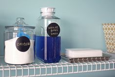 Glass jars and pitchers an easy way to store detergents and look pretty in the laundry room. #LGatBBC
