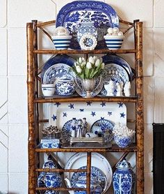 The blue and white pieces are arranged beautifully on the burnt bamboo etagere. I like the cornishware, the blue willow & the more formal ginger jars all mixed together. Blue Dishes, White Dishes, Blue And White China, Blue China, Blue Rooms, White Rooms, Decoration Restaurant, Ideas Hogar, Blue Plates