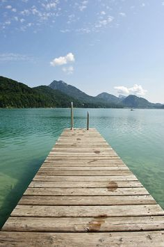 Enjoy a summer day relaxing on a wooden jetty at lake Fuschlsee near Salzburg, Austria #austria #salzburg #fuschlsee #lake #summer #relaxation #visitaustria