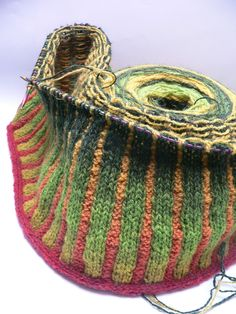 Kauni yarn -- found a pattern on Ravelry to make a striped cardigan with this yarn that looks similar to this pin -- it's triangle shaped on the bias using basic knitting stitches I can probably manage. Knitting Designs, Knitting Stitches, Knitting Yarn, Hand Knitting, Yarn Projects, Knitting Projects, Crochet Projects, Diy Laine, Knitting Patterns