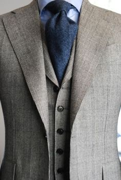 I love this rich textured blue tie. So classy and elegant with the 3 piece suit.