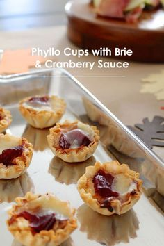thanksgiving eats: phyllo cups with brie and cranberry sauce #thanksgiving #theeverygirl